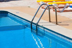 Ladder in the swimming pool Stock Image