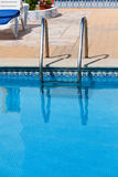 Ladder in the swimming pool Royalty Free Stock Photos