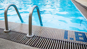 Ladder in swimming pool Royalty Free Stock Images
