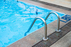 Ladder in swimming pool Stock Photos