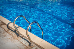 Ladder of a swimming pool. Horizontal shot Stock Photo