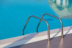 Ladder of a swimming pool Stock Photography