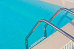 Ladder of a swimming pool Stock Photos