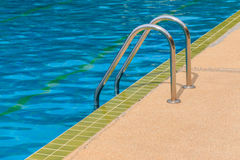 Ladder of the swimming pool Stock Photography