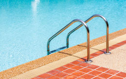 Ladder of swimming pool in summer time Royalty Free Stock Photography