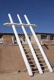 Ladder to 900 Year Old Adobe Pueblo Heaven. These ladders have been used traditionally for 900 years to climb upon continuously inhabited southwestern pueblo Stock Photos
