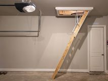 Ladder to attic in garage of a new house TX Royalty Free Stock Images