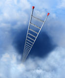 Ladder to heaven. A ladder with red anti-slip shoes leaning into the clouds Stock Photo