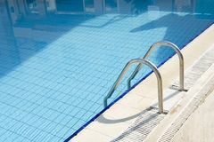 Ladder to pool. Entrance ladder to a swimming pool Stock Images