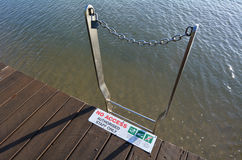 Ladder to sea with No access to water signs and symbols Stock Photography