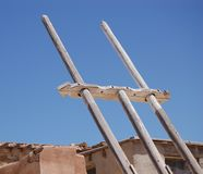 Ladder to the Sky. Ladder of faded pine wood of unknown age. Hand-carved. Used by the ancients -- the Acoma Pueblo native Americans -- to reach higher levels of royalty free stock images