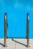 Ladder to swiming pool. Metal ladder to swimming pool Royalty Free Stock Images