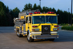 Ladder Truck Front. This is a picture of the front of a yellow fire truck used for reaching fires in high places, such as, tall office buildings Stock Images