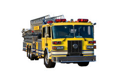 Ladder Truck Front Isolated. This is a picture of the front of a yellow fire truck used for reaching fires in high places, such as, tall office buildings Royalty Free Stock Photo
