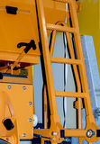 Ladder on a truck for garbage collection. Retractable ladder on cargo specialist car yellow stock photo