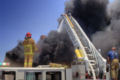 Ladder Truck puts out fire Stock Images