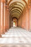 Renaissance portico. Ladder under Renaissance portico with arches and columns of red brick Royalty Free Stock Image
