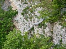 Ladder voor afdaling op een klip van kalksteen royalty-vrije stock foto