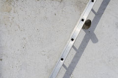 Ladder on a wall Royalty Free Stock Photography