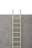 Ladder on wall Stock Photography