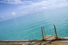 Ladder way into sea in maldives. Royalty Free Stock Photography