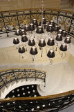 Ladder. White Classic Forged Staircase Chandelier Marble Top Private Black interior railings Royalty Free Stock Photo