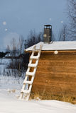 Ladder on wooden hut lapland in winter Royalty Free Stock Images