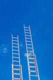 Ladders. Aluminum ladders on blue sky background stock images