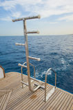 Ladders on the back of a luxury motor yacht Stock Photography