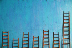 Ladders on blue wall Royalty Free Stock Photography