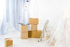 Ladders and boxes in new. Empty apartment stock image