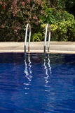 Ladders and its reflection at swimming pool Stock Photo