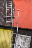 Ladders on painted tin roof. Stock Photography