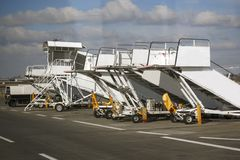 Ladders for the plane stand. In a row at the airport royalty free stock photo