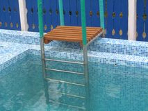 Ladders for pools. Ladder in a small pool Royalty Free Stock Photography