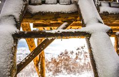 Snow and ladders. Ladders to the wooden cottage.White winter stock image