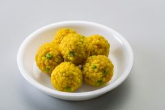 Laddu or laddoo are ball-shaped sweets popular in the Indian subcontinent. Laddus are made of flour, minced dough and sugar with other ingredients that vary by stock photography