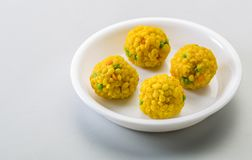 Laddu or laddoo are ball-shaped sweets popular in the Indian subcontinent. Laddus are made of flour, minced dough and sugar with other ingredients that vary by royalty free stock photo