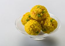 Laddu or laddoo are ball-shaped sweets popular in the Indian subcontinent. Laddus are made of flour, minced dough and sugar with other ingredients that vary by stock images