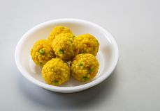 Laddu or laddoo or motichoor laddu. Laddu or laddoo are ball-shaped sweets popular in the Indian subcontinent. Laddus are made of flour, minced dough and sugar stock photography