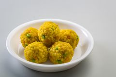 Laddu or laddoo or motichoor laddu. Laddu or laddoo are ball-shaped sweets popular in the Indian subcontinent. Laddus are made of flour, minced dough and sugar royalty free stock photography