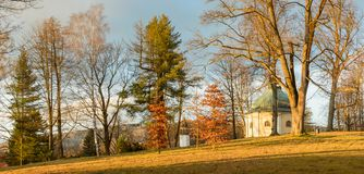 Ladek Zdroj, Chapel of St. George in the park. Poland, Ladek Zdroj, Chapel of St. George in the park europe sudety georges grass trees branches building leaves stock photo
