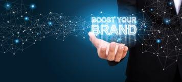 Laden Sie Ihre Marke in der Hand des Geschäfts auf Laden Sie Ihr Marke conce auf lizenzfreies stockfoto