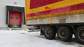 Laden truck starts to move from the warehouse. 28 November 2015 Novosibirsk stock video