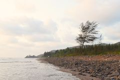 Ladghar Beach - Serene Seascape with Greenery and Hills - Natural Wallpaper. This is a photograph of serene and secluded Ladghar beach in Konkan region in India Royalty Free Stock Image