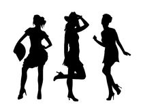 Ladies. Dancing silhouettes, black on white Royalty Free Stock Photos