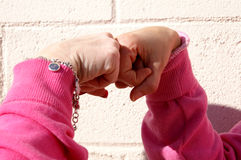 Ladies Agreement. Ladies hitting their fist together to signal agreement or achievement Stock Image