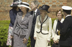 Ladies awaiting arrival of Queen Elizabeth II Royalty Free Stock Photography