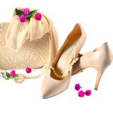 Ladies bag, shoes and jewelry isolated on white background. stock photos
