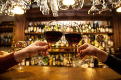 Ladies is bar. With red wine Royalty Free Stock Photo